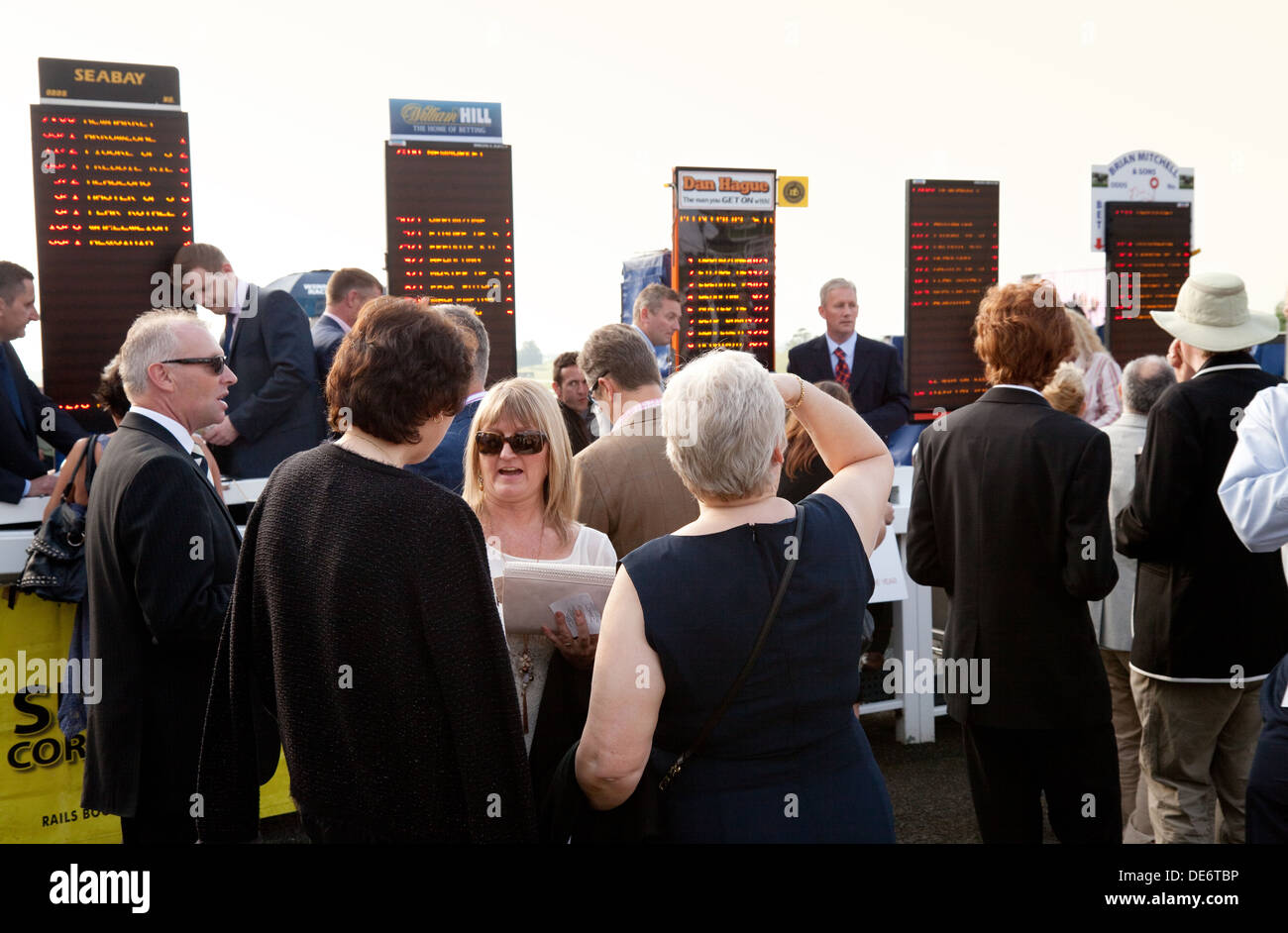People betting on the horses at Newmarket Races, the July racecourse, Newmarket Suffolk UK - Stock Image