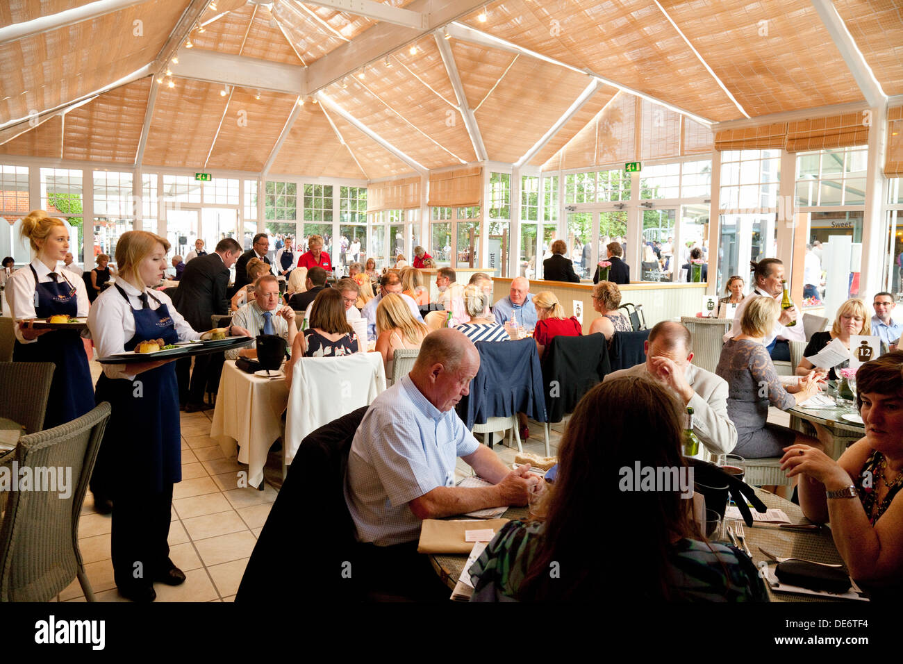 People eating in the Summerhouse restaurant, the Premier Enclosure,  the July Racecourse  Newmarket Suffolk UK - Stock Image