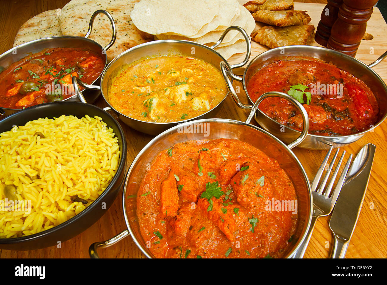 Varied selection of indian cuisine on table including chicken tikka varied selection of indian cuisine on table including chicken tikka beef rogan josh chicken jalfrezi and chicken korma forumfinder Choice Image