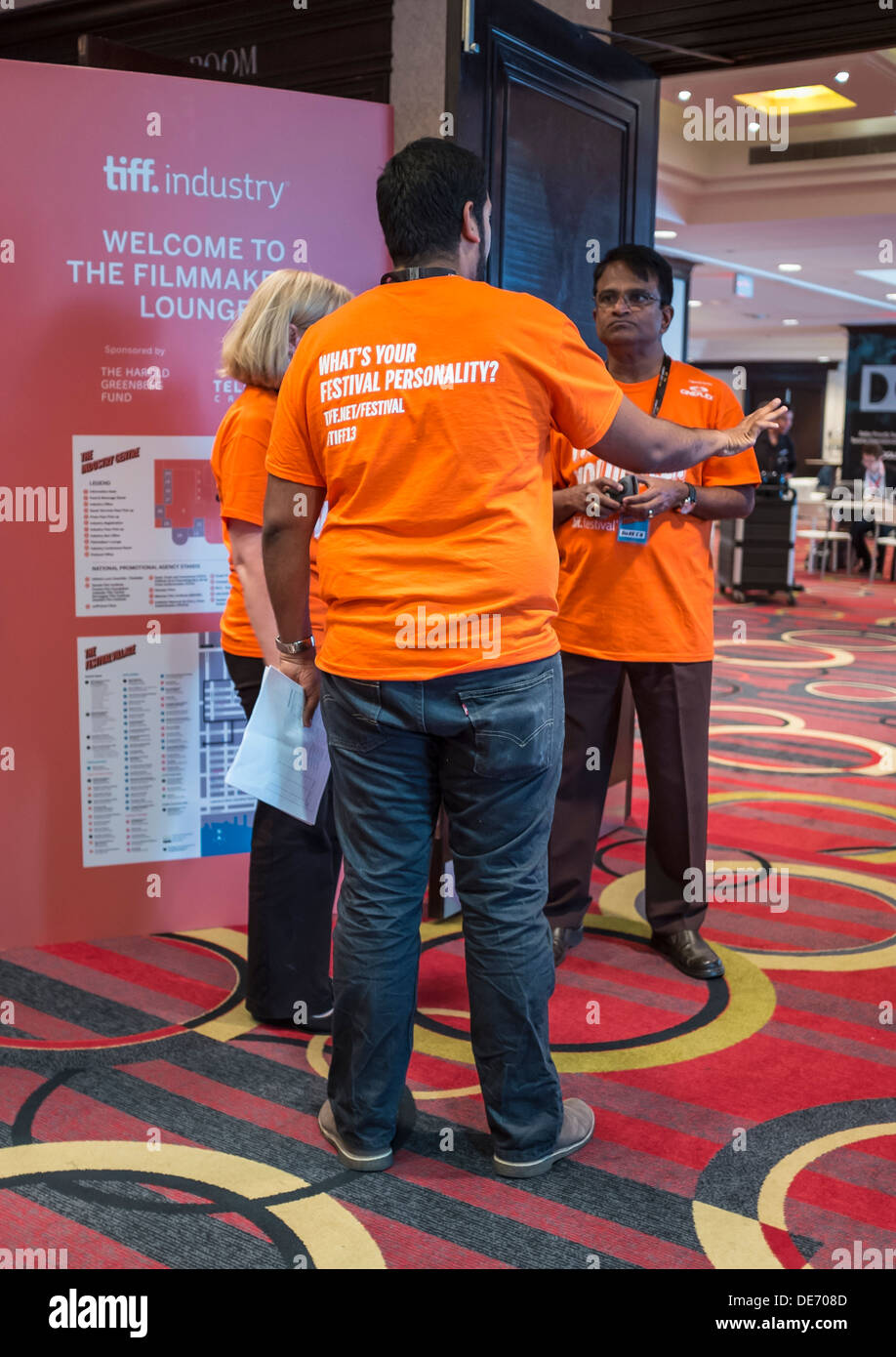 Volunteers at the entrance of the film maker's lounge at the TIFF Bell Lightbox  2013 Toronto International Film Festival - Stock Image