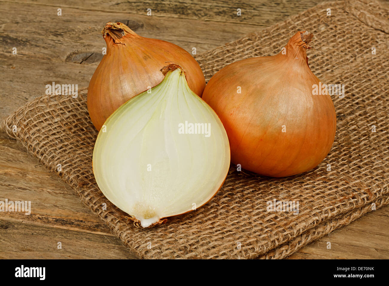 fresh onions a common vegetable in a traditional rustic setting - Stock Image