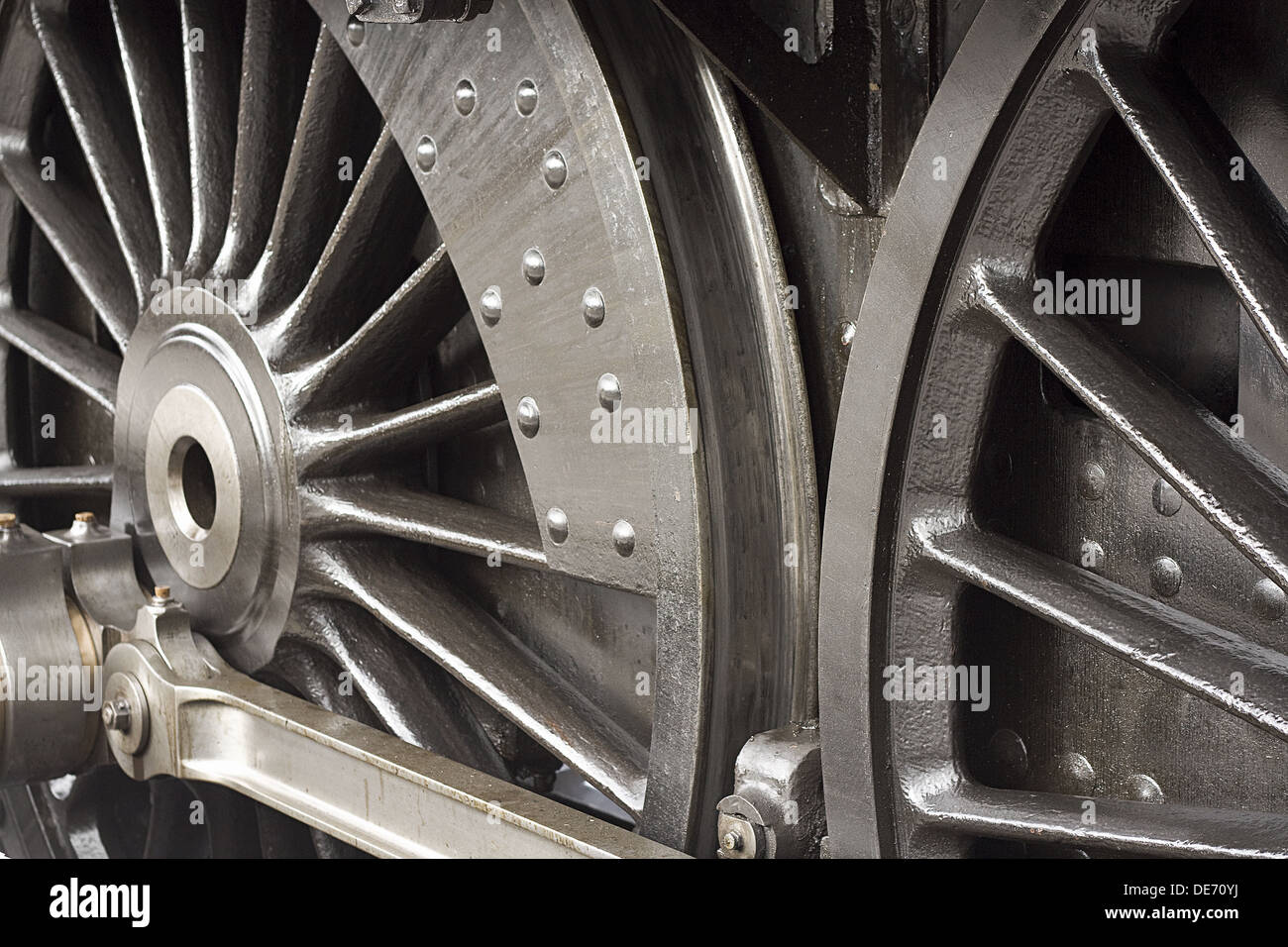 Steam train wheels close up detail shot of the chassis or running gear - Stock Image