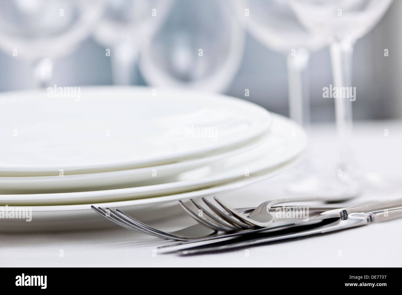 Elegant restaurant table setting for fine dining with plates cutlery and stemware & Elegant restaurant table setting for fine dining with plates cutlery ...