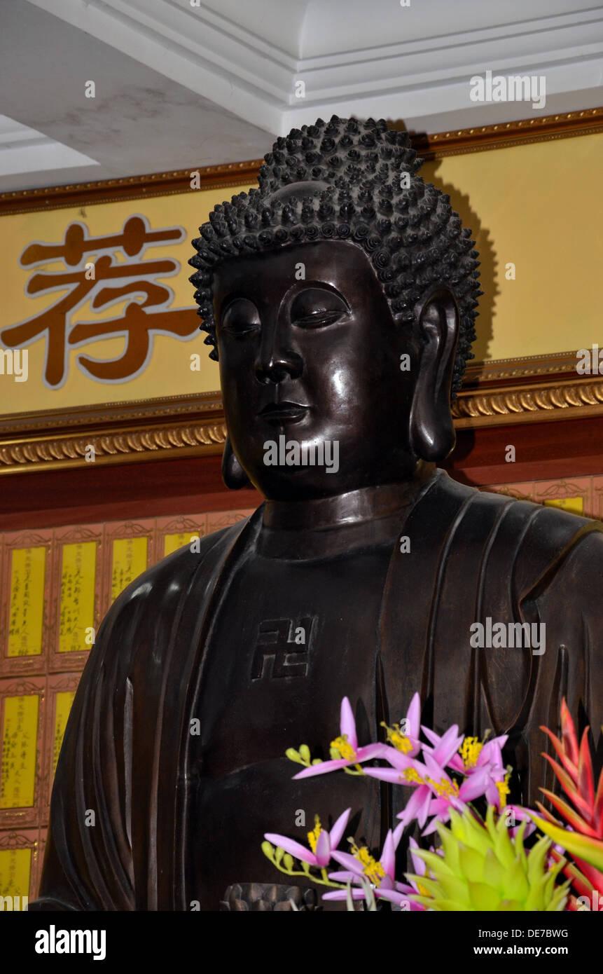Black carved statue of Buddha Sakyamuni - Stock Image