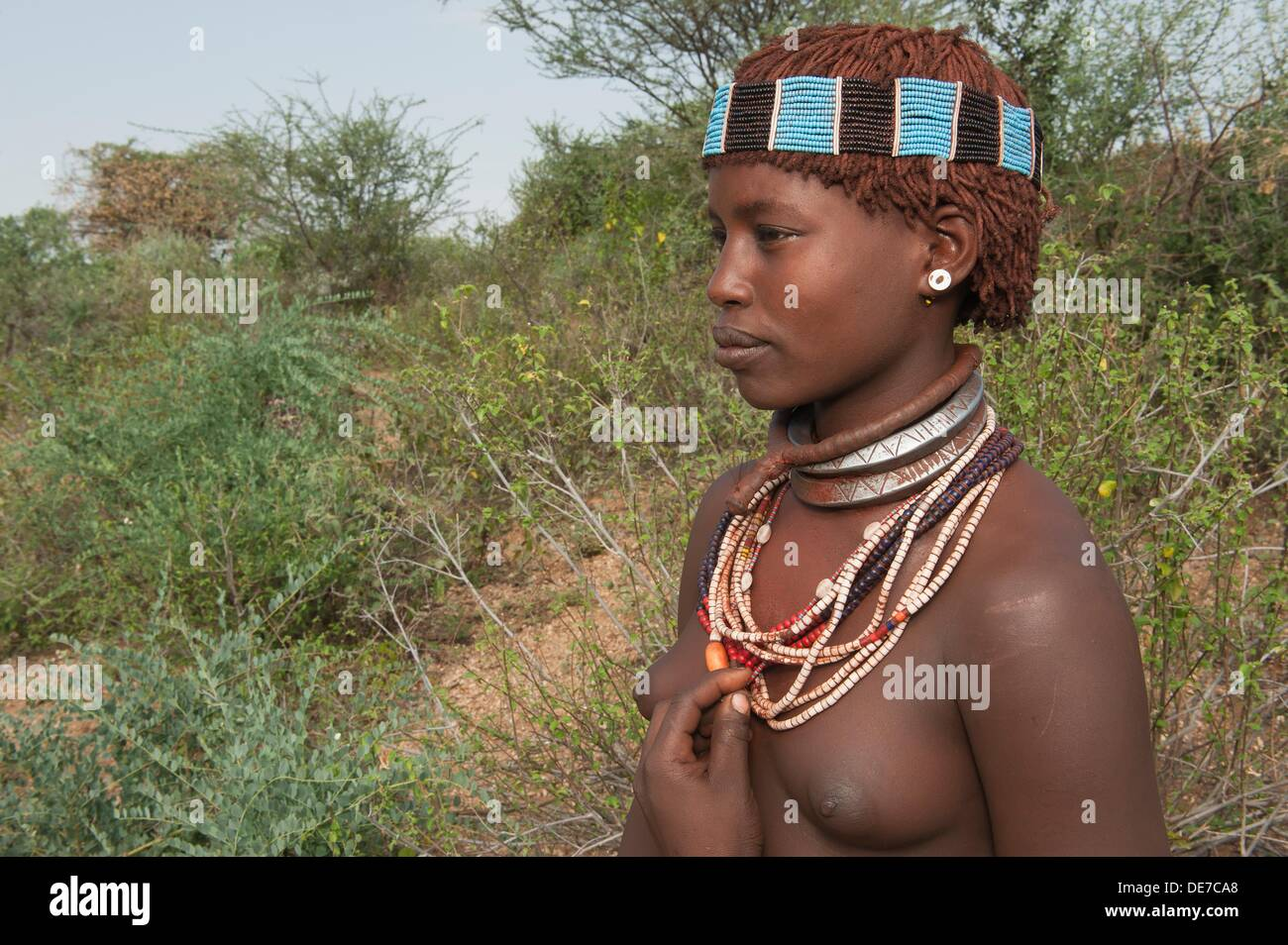 Young Hamar woman with necklaces and hair adornment, Omo river valley, Southern Ethiopia - Stock Image