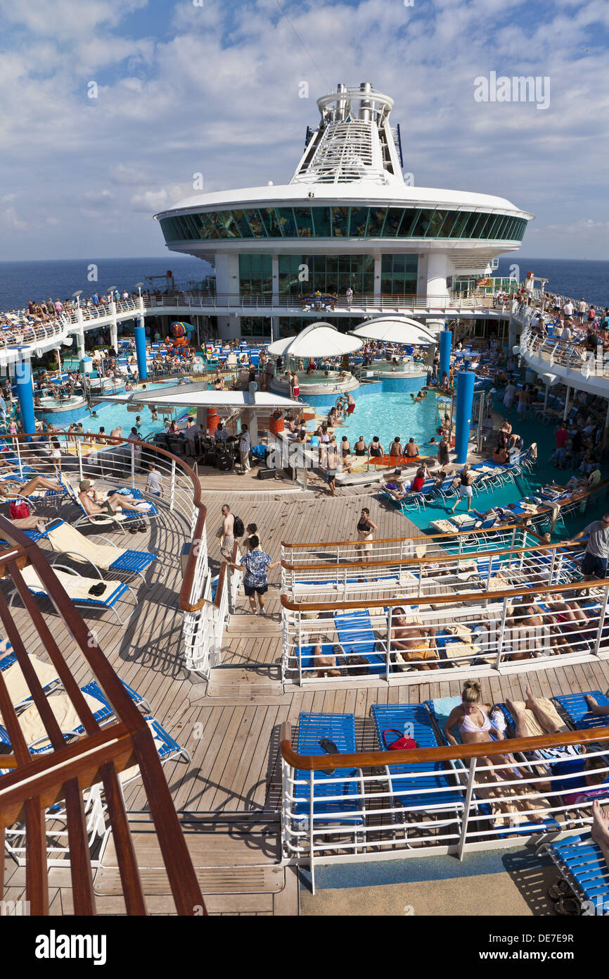 People on deck around swimming pool on Royal Caribbean Navigator of the Seas cruise ship Stock Photo