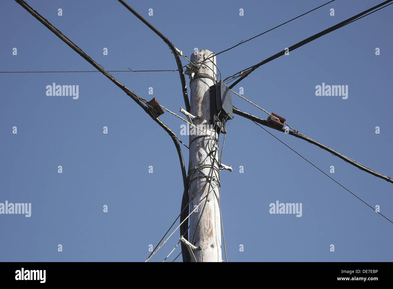 Telegraph pole with linking cables Stock Photo
