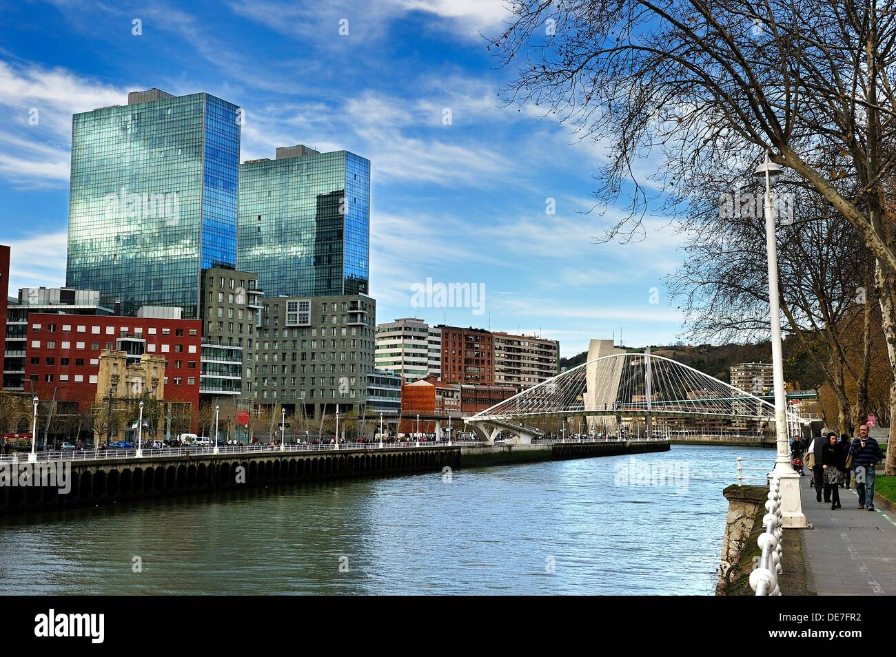 More modern image of Bilbao, River view of the bridge by Santiago Calatrava and Towers Isozaki - Stock Image