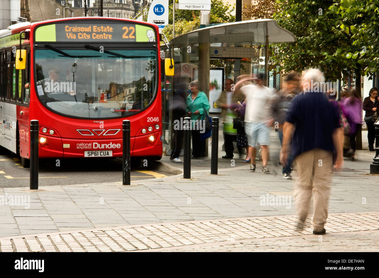 People stepping off a National Express City Bus at the terminus outside the Overgate Shopping Mall in Dundee, UK - Stock Image