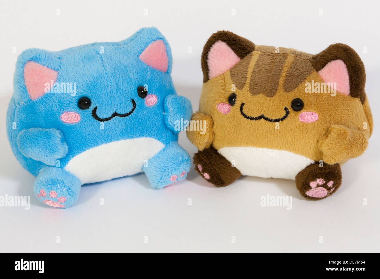 Two stuffed toys won from a claw machine - Stock Image