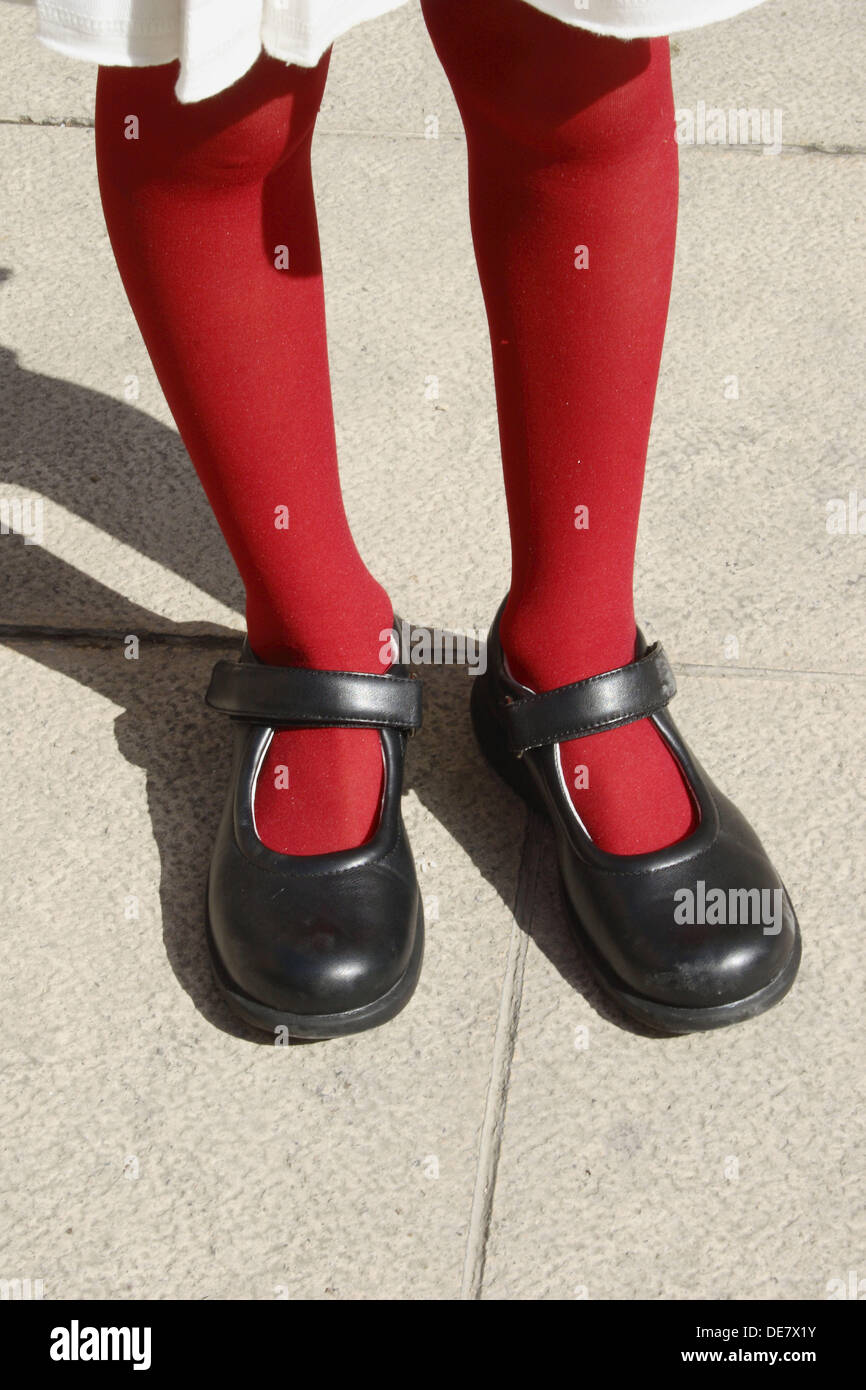 6 year old girl´s legs with red stocking - Stock Image