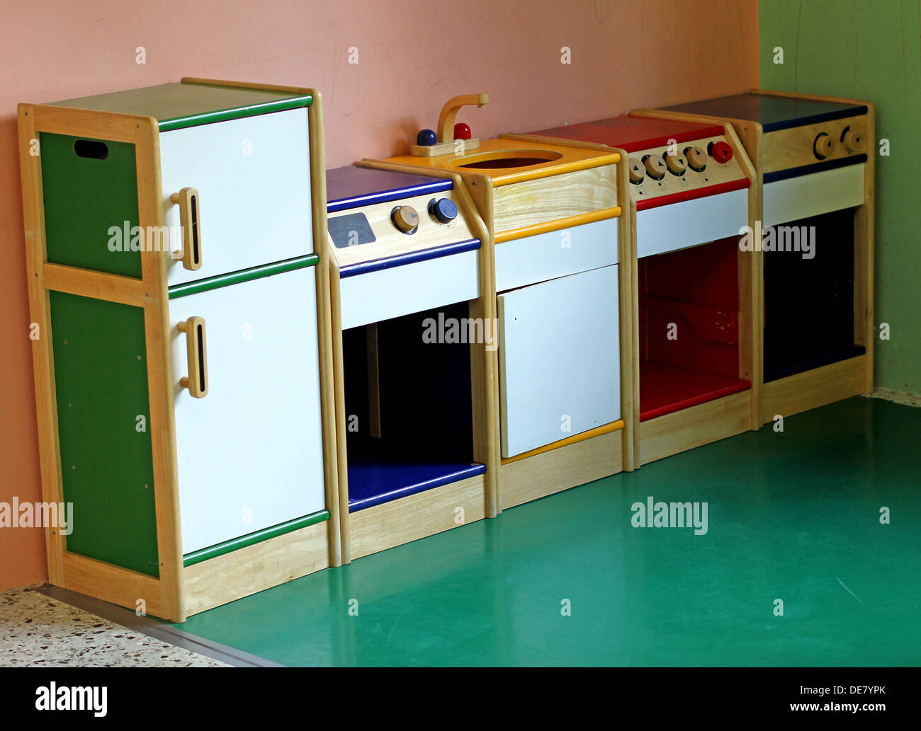 Small Wooden Toy Kitchen To Play And Amuse The Children Of A