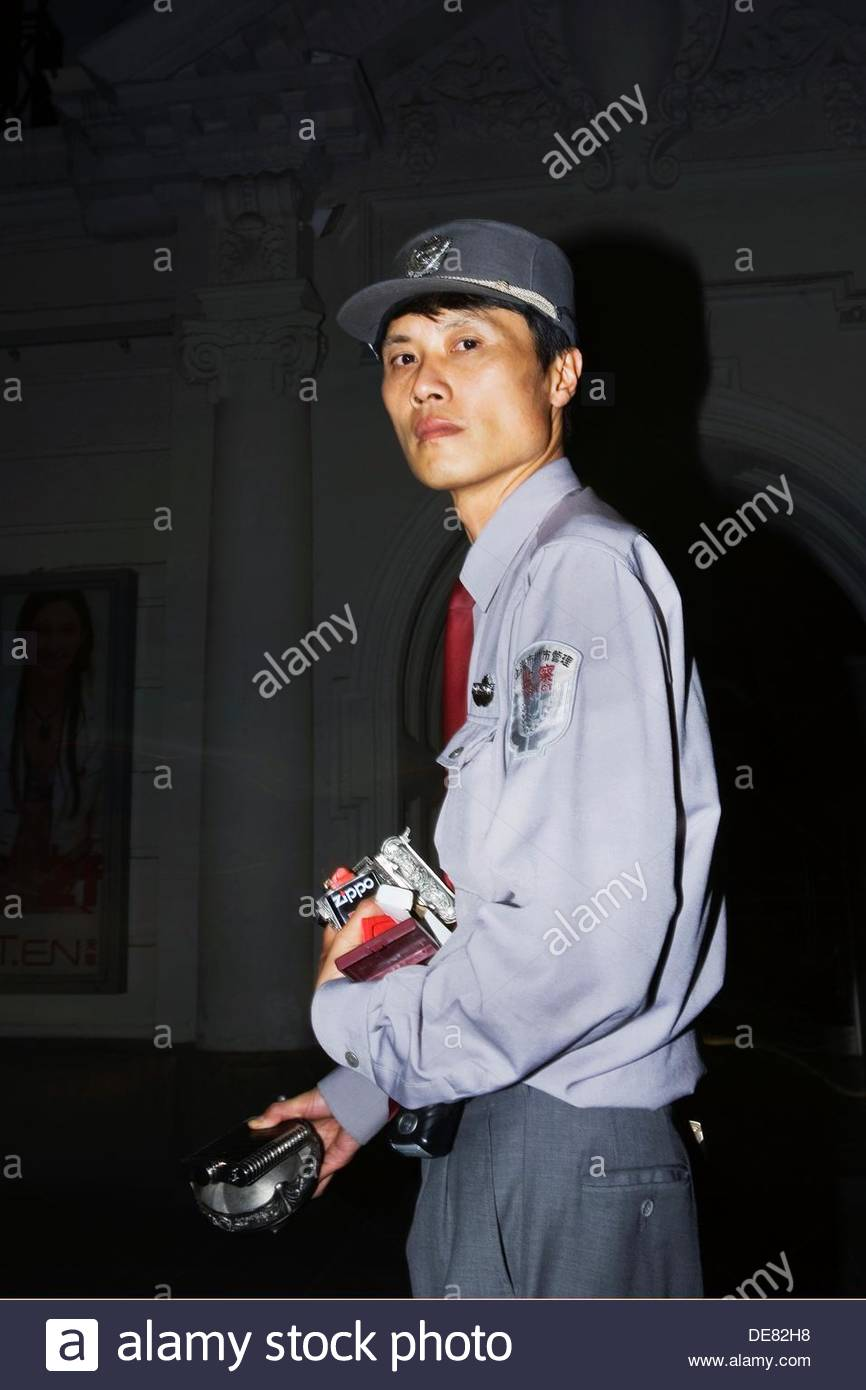 NR Government Inspector with confiscated repro fake branded goods taken from street hawkers in Nanjing road - Stock Image