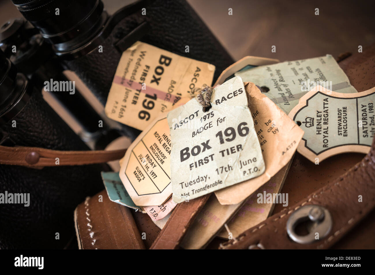 A pair of Binoculars with a leather case display the passes for long forgotten races at Ascot and the Henley Regatta. - Stock Image