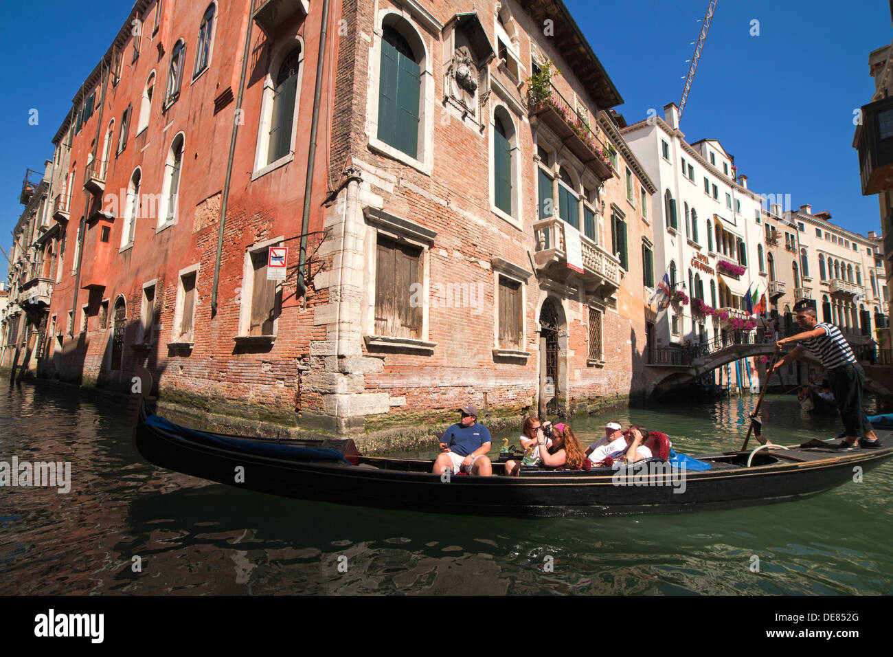 gondola with tourists in Venice, Italy - Stock Image