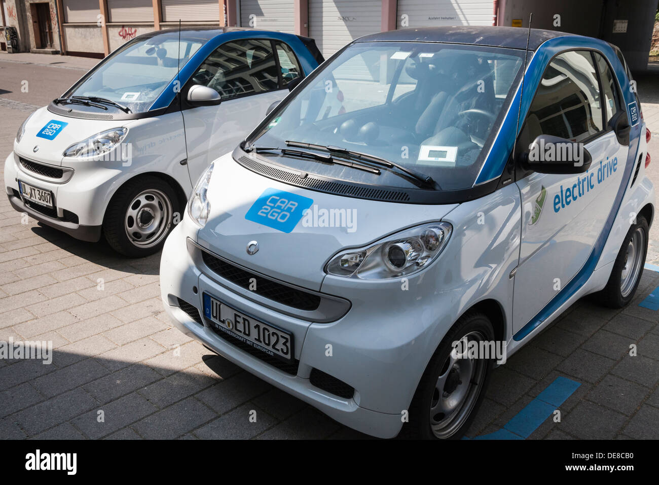 Germany, Baden Wuerttemberg, Ulm, Conventional and electric car - Stock Image