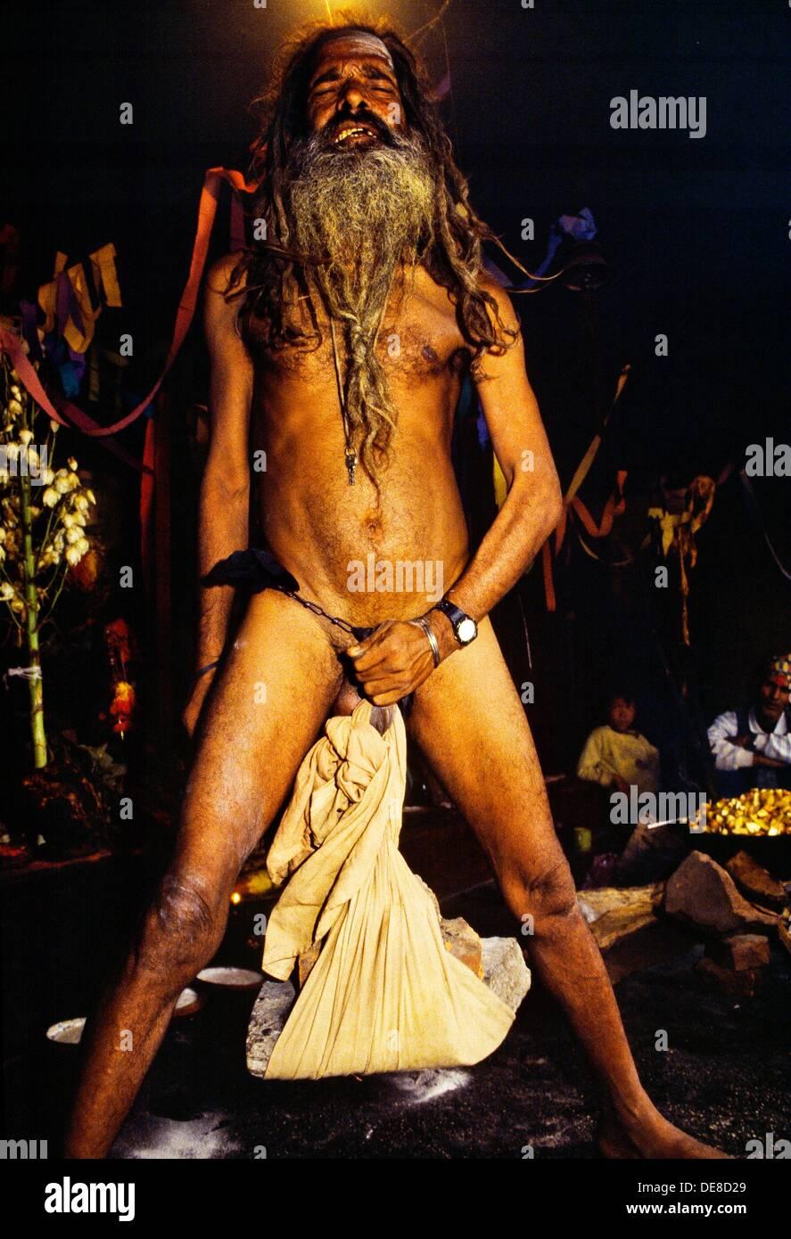 Sadhu holy man with very long rasta style dreadlock hair  Exibition  Pasupatinath  Katmandhu  Nepal - Stock Image