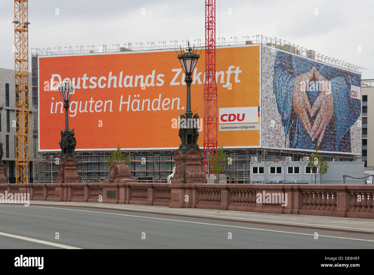 Large poster of the CDU German Chancellor Angela Merkel,  with a typical attitude called the 'Merkel rhombus', Berlin - Stock Image