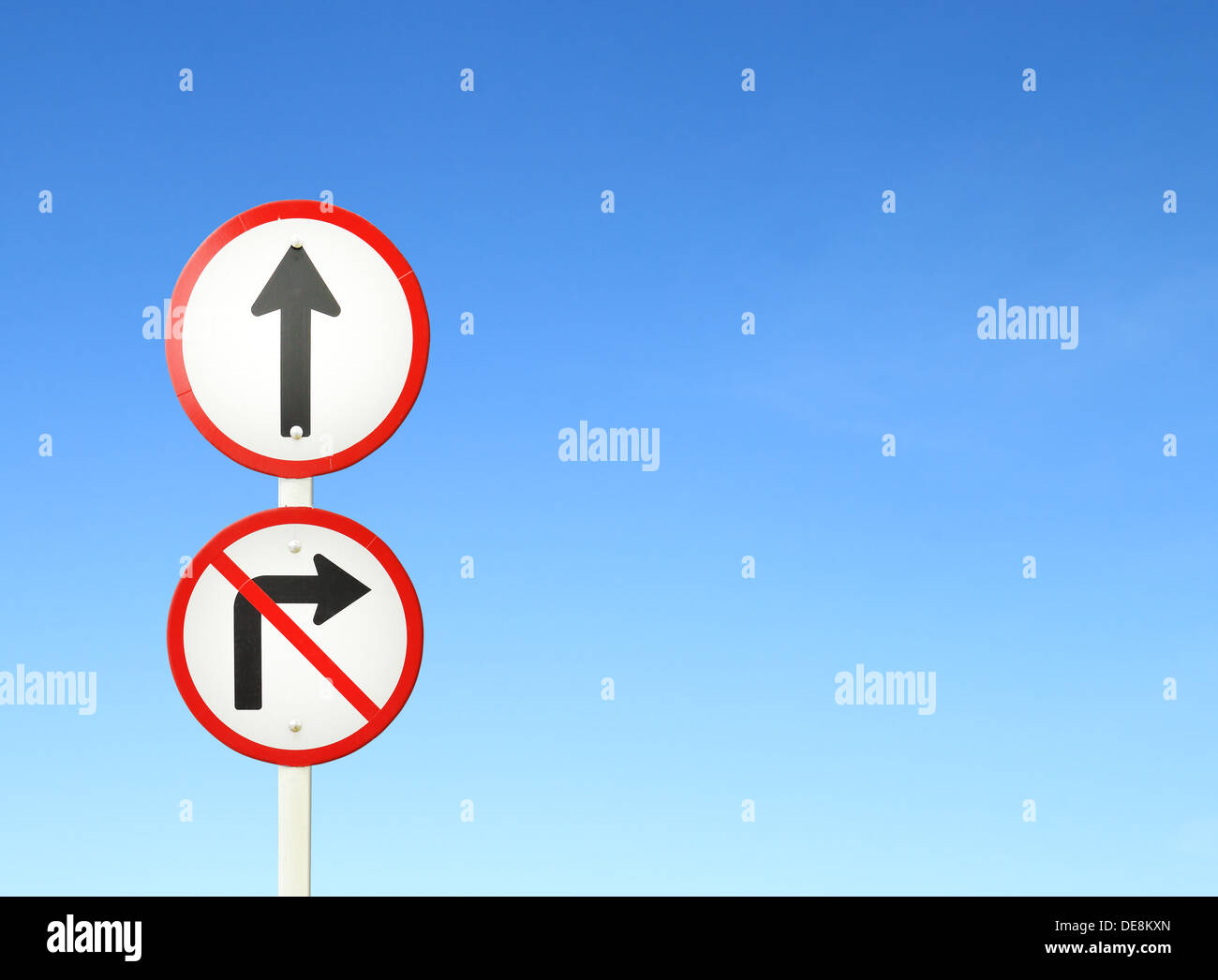 go ahead the way ,forward sign and don't turn right sign with blue sky blank for text - Stock Image