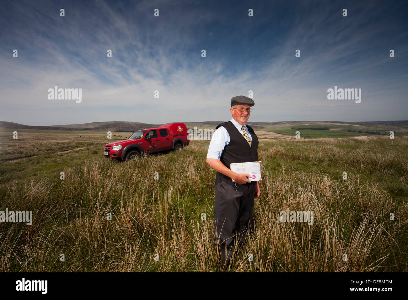 Postman in the Pennines , Yorkshire delivering mail to remote farms on the tops - Stock Image