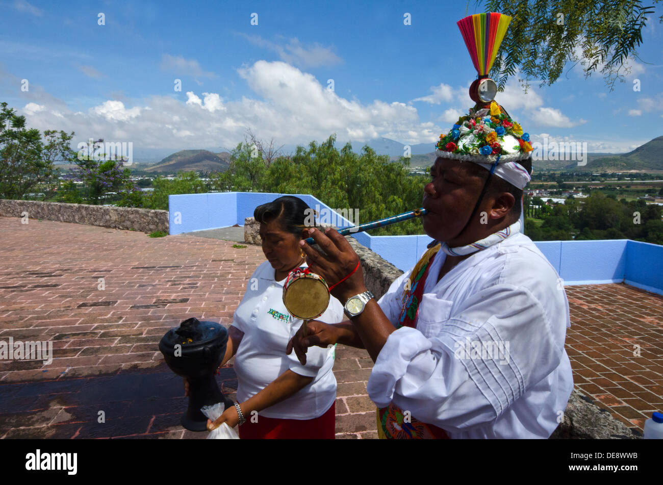 Volador playing the flute and drum during the ritual before the tree trunk is erected for future Voladores displays in Mexico. - Stock Image