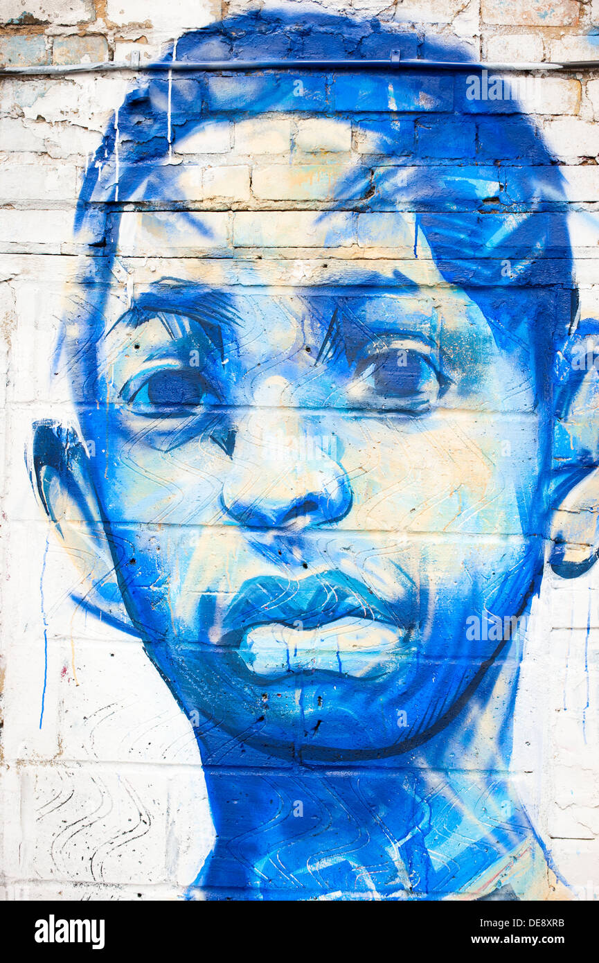 East End London Fish Island Hackney Wick graffiti graffitti grafitti grafiti street art letters colourful colorful detail blue ethnic face head - Stock Image