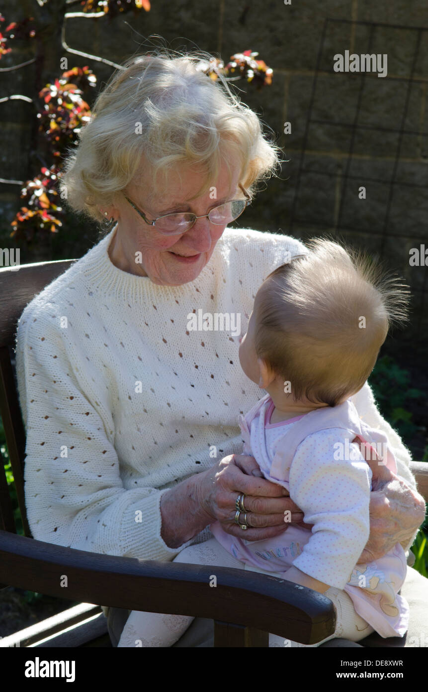 great grandmother in eighties with great granddaughter eight months old - Stock Image