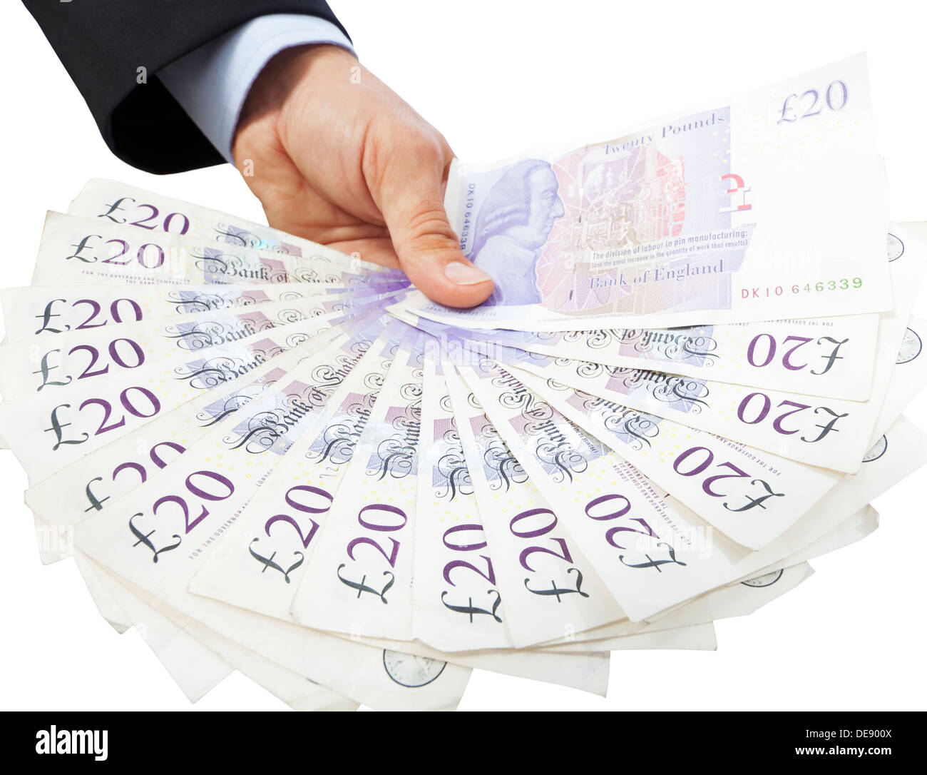 Close-up of a hand holding a fan of twenty pound notes against a white background. - Stock Image