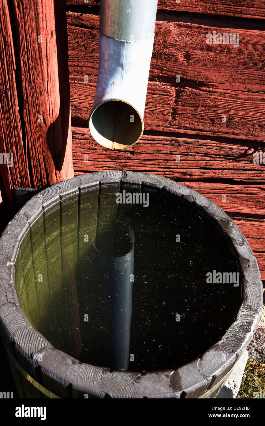 Drainpipe and Water Barrel - Stock Image