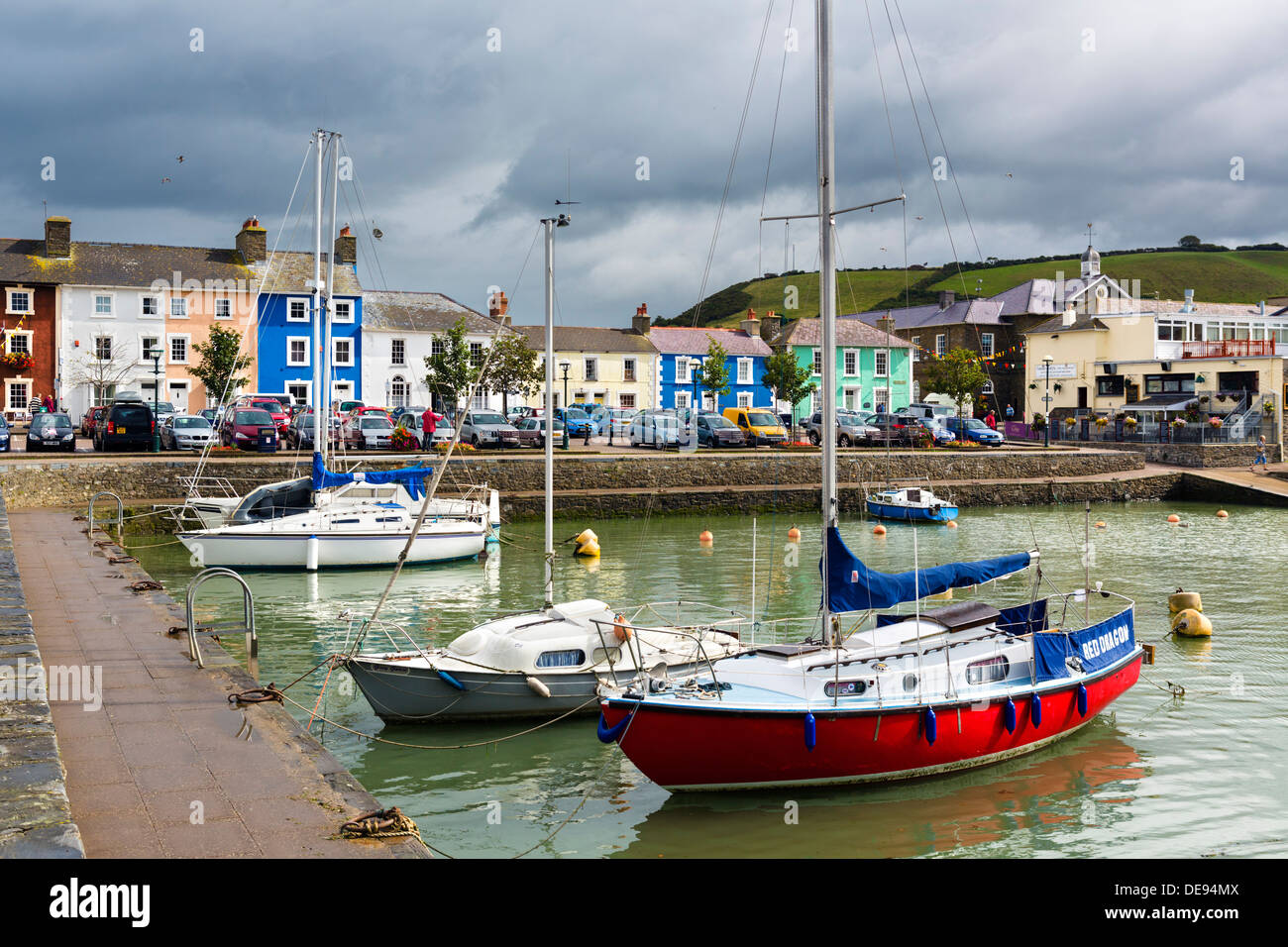 Boats in the harbour in the seaside village of Aberaeron, Ceredigion, Wales, UK - Stock Image