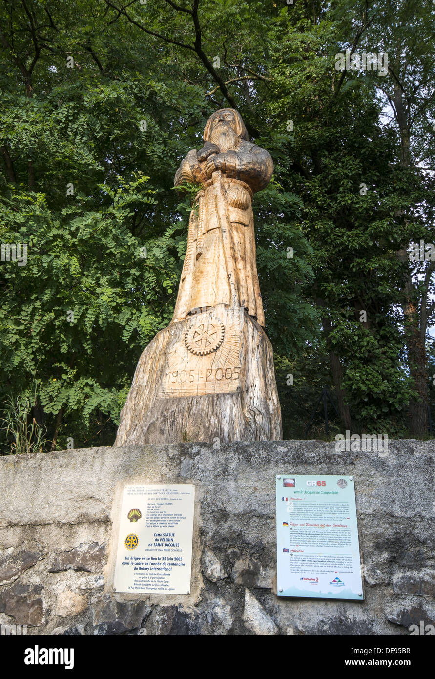 A large wooden sculpture of St James the pilgrim on the GR65 the Way of St James walking out of Le Puy-en-Velay in France - Stock Image