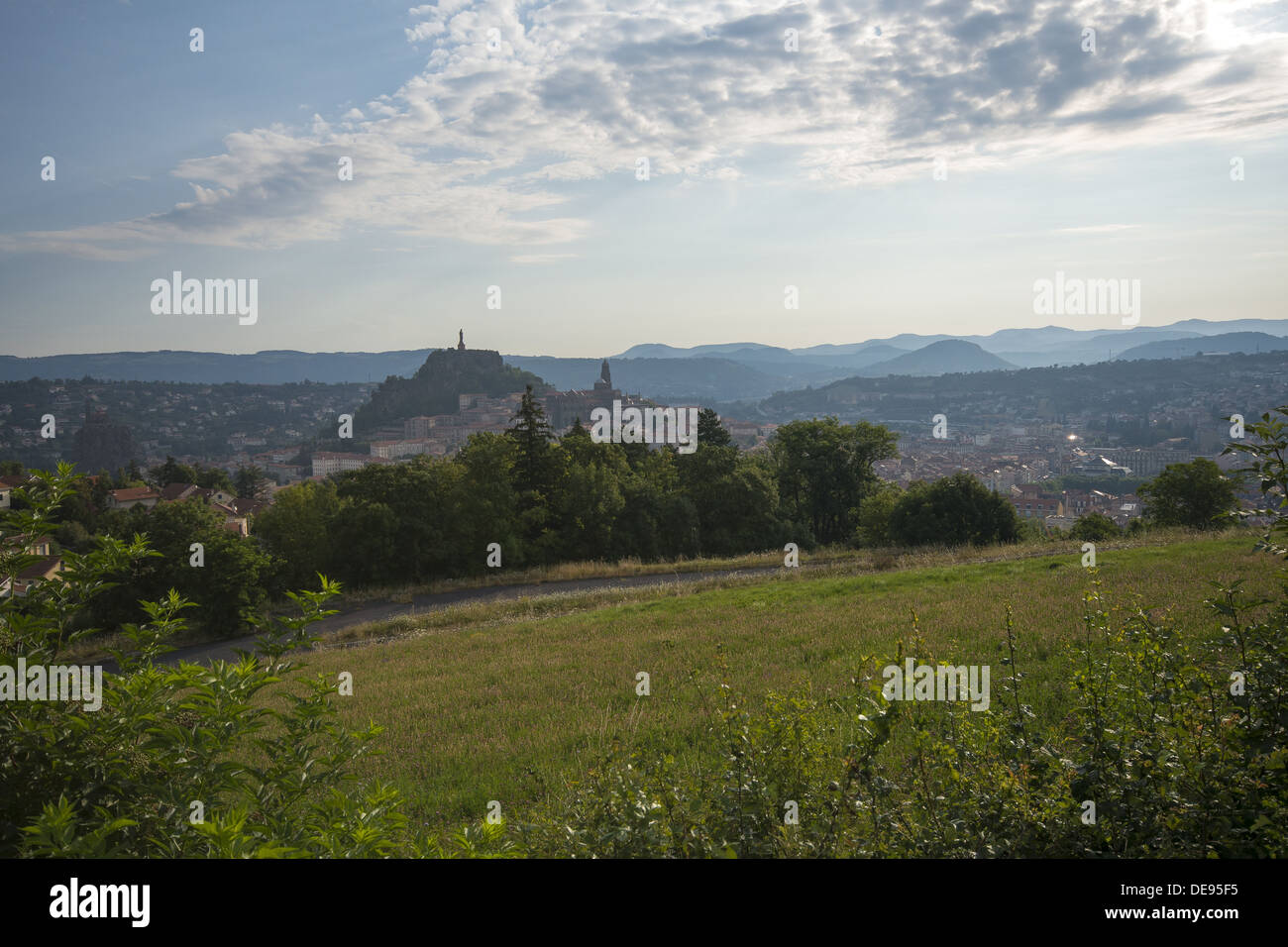 Looking back on Le Puy-en-Velay in the morning light from the GR65 walking route the Way of St James in France - Stock Image