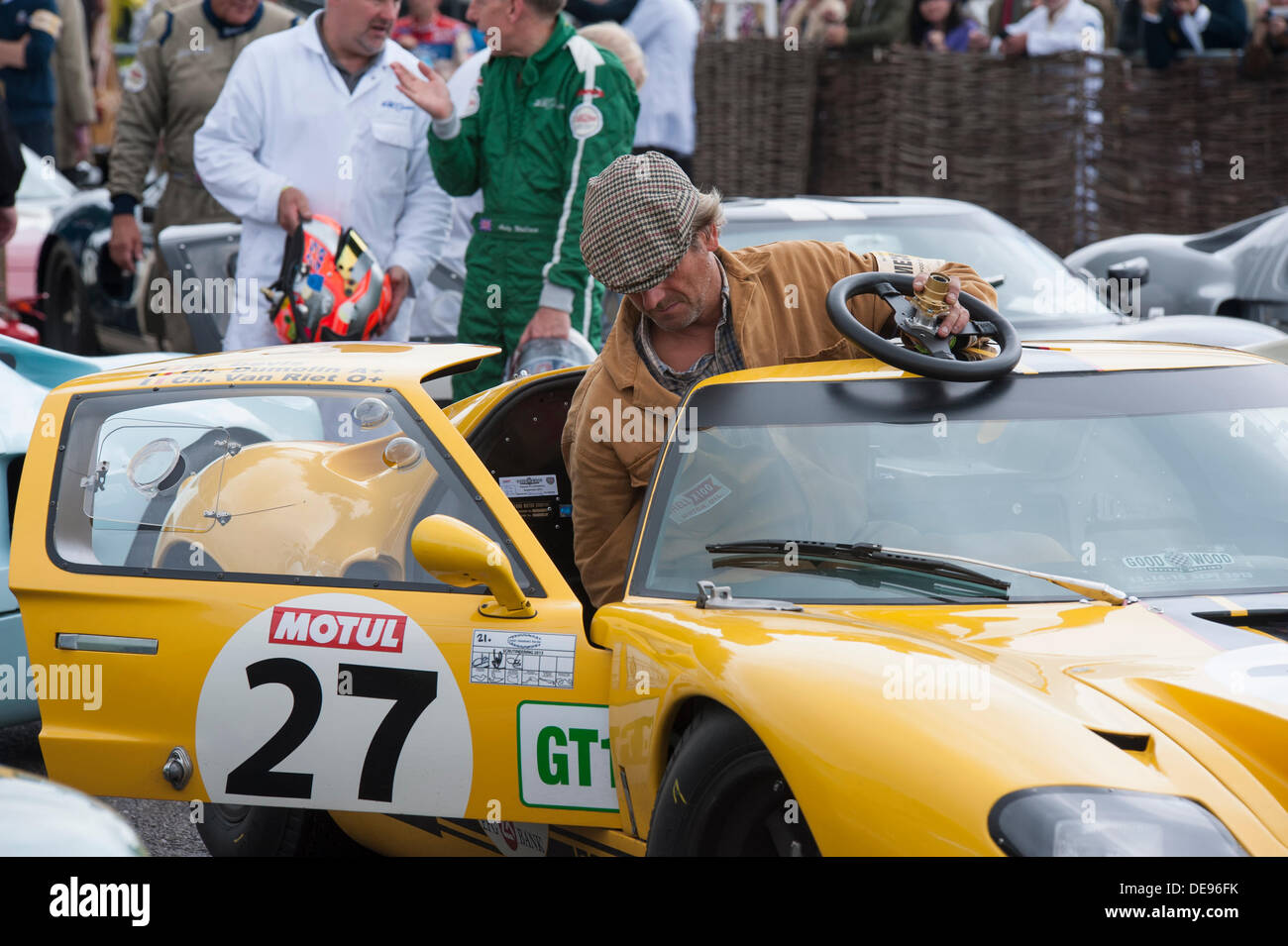 Middle Aged Man Wearing Flat Cap Is Seen Getting Into A Ford Gt  He Has Removed The Steering Wheel For Easier Access And Is Still Holding It In His Hand