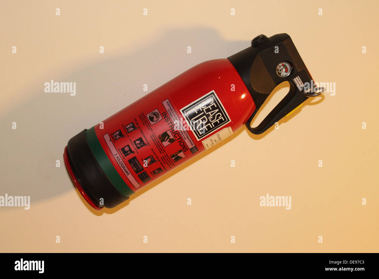 A fire extinguisher mounted on wall - Stock Image