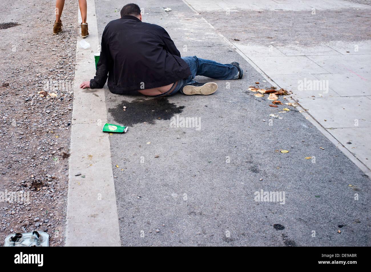 Drunk Man Sitting On Pavement Stock Photo 60442027 Alamy