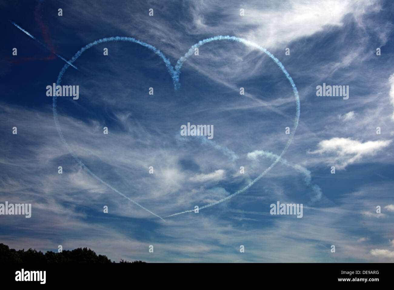 Heart in the sky,drawn by the Red Arrows air display team, England, UK - Stock Image