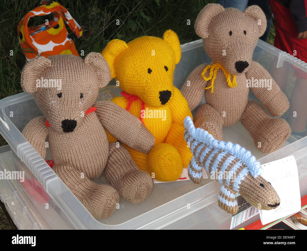 Hand knitted craft bears on sale at a charity fayre, Cheshire, England,UK - Stock Image