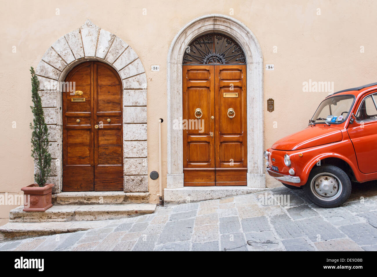 A red Fiat 500 parked next to two Renaissance doors in Montepulciano Tuscany Italy. & A red Fiat 500 parked next to two Renaissance doors in Montepulciano ...