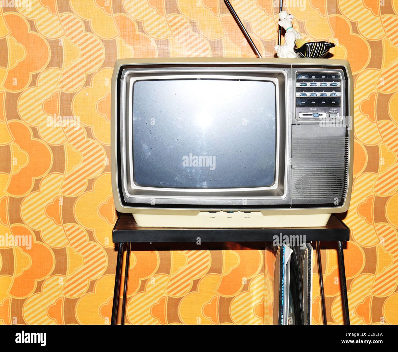 Old TV Set Against Vintage Wallpaper Background