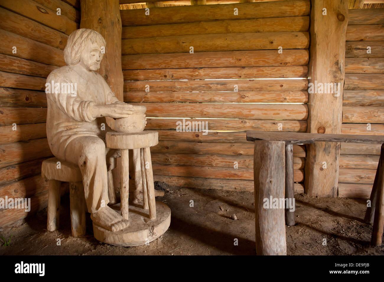 Slav worker sculpture inside hut Stock Photo