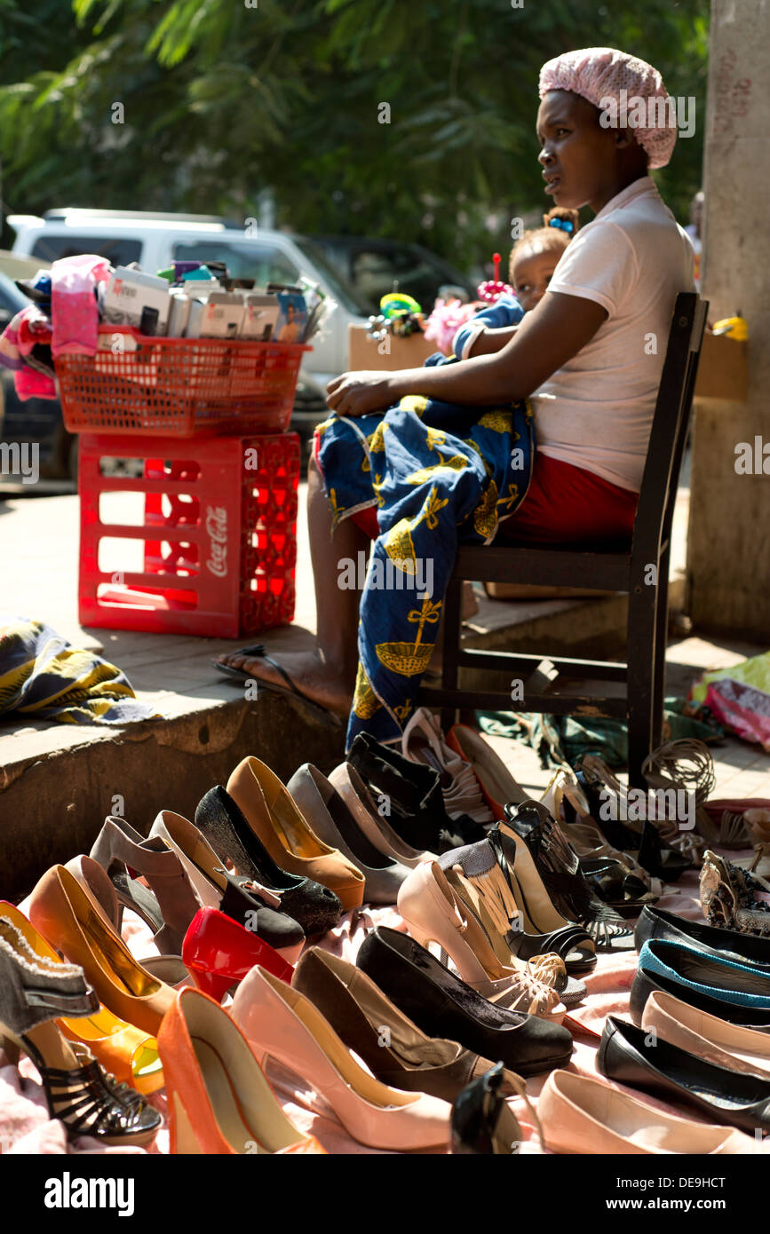 Woman selling women's shoes and tights, Luanda, Angola - Stock Image