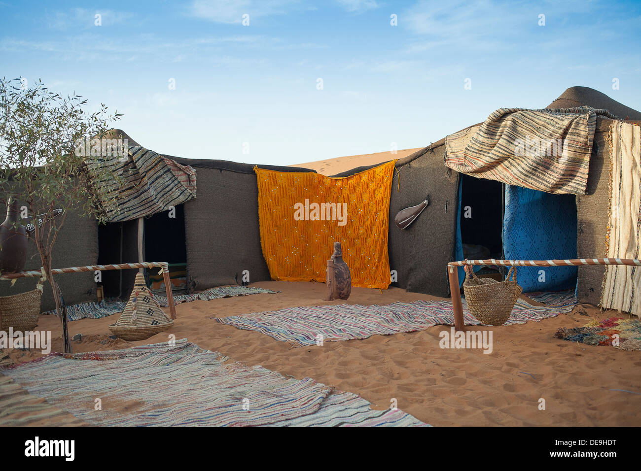 berber tent camp in the moroccan sahara at sunset stock photo