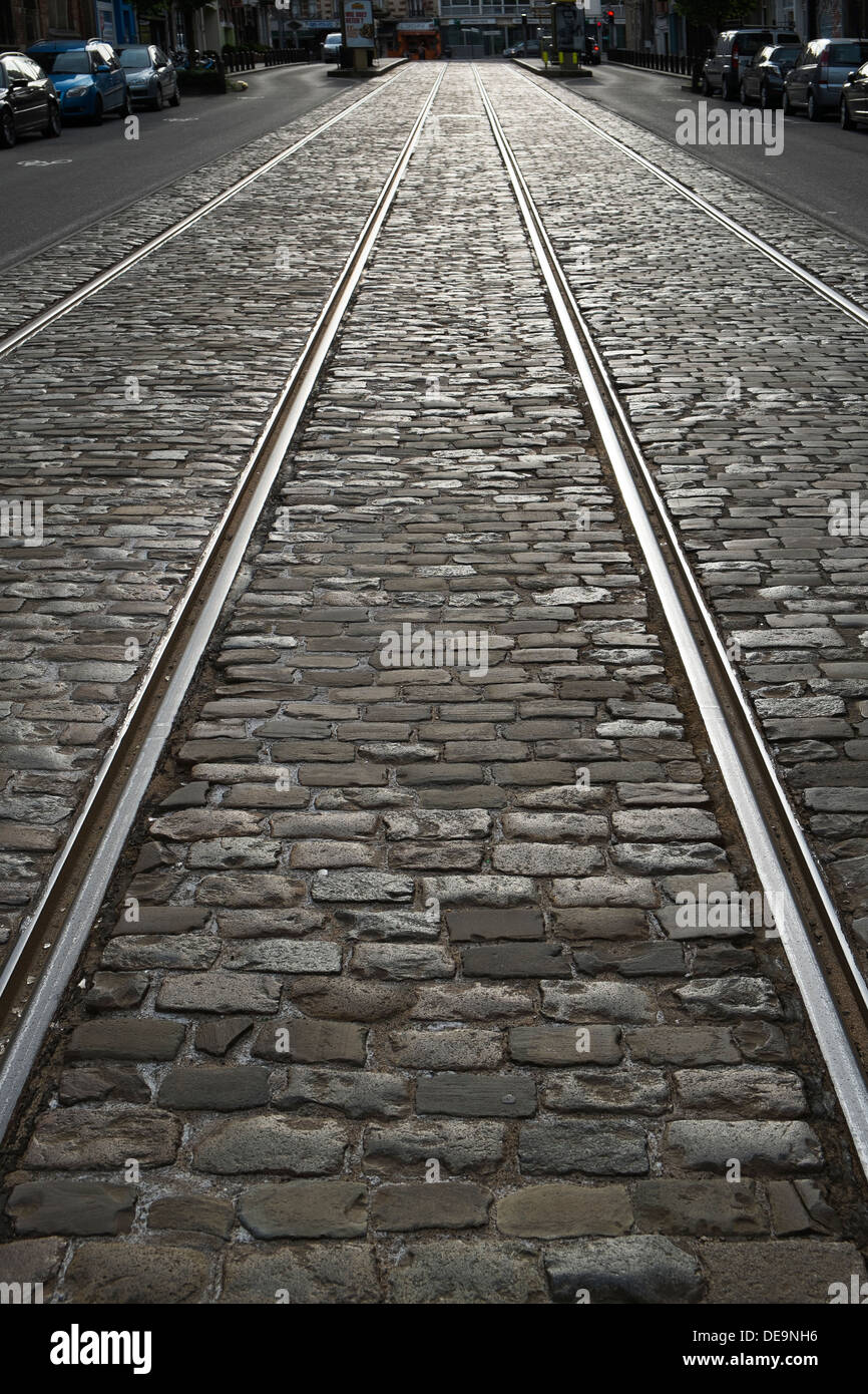tram tracks cobbled street - Stock Image