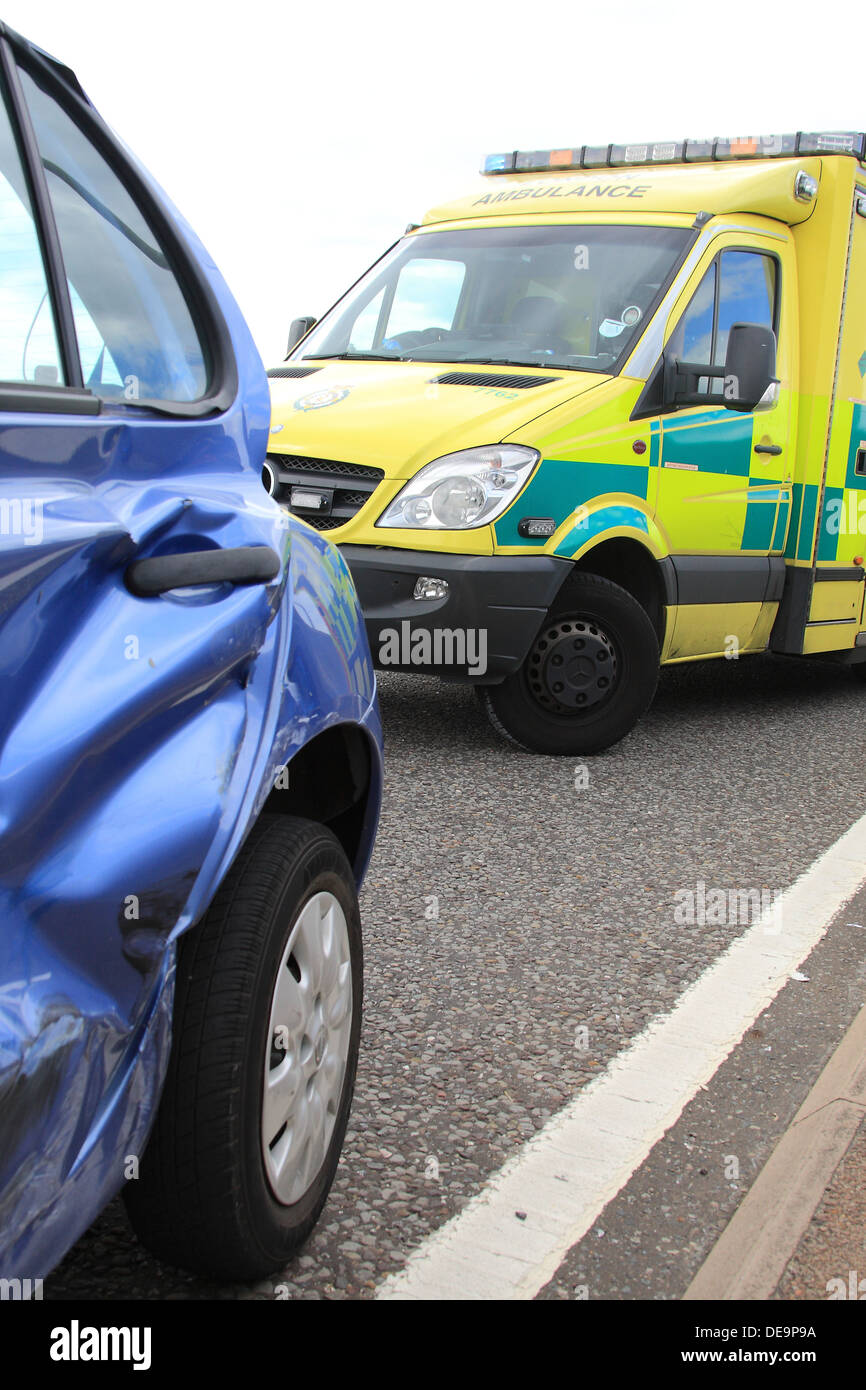 An NHS ambulance from London Ambulance service at the scene of a car crash as the demand on A+E services continues to be debated - Stock Image