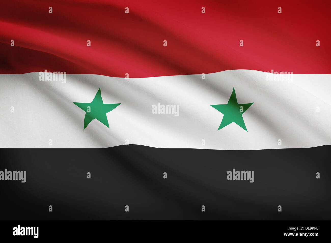 Syrian flag blowing in the wind. Part of a series. - Stock Image