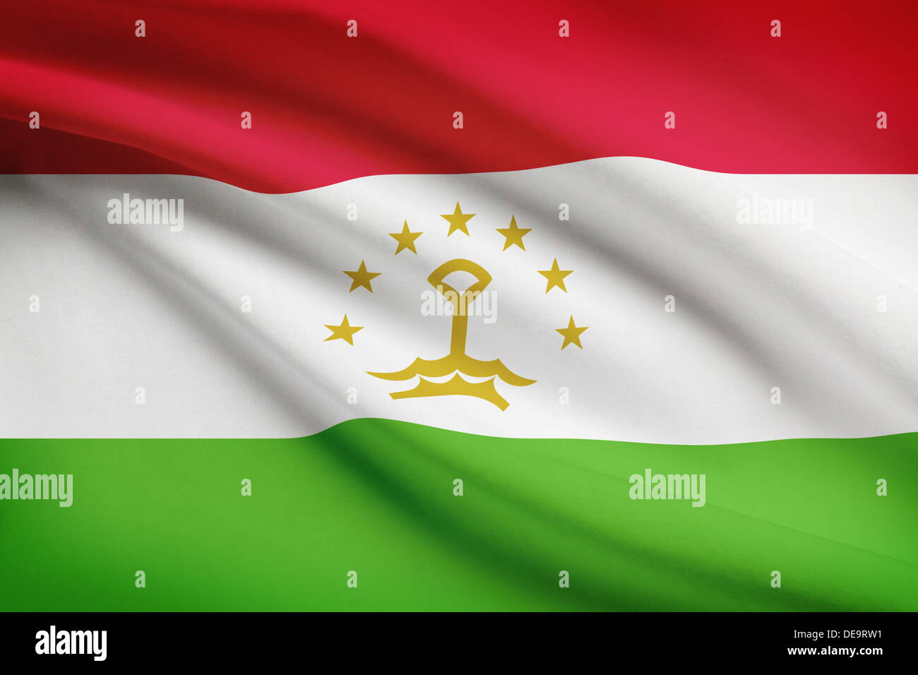 Tajik flag blowing in the wind. Part of a series. - Stock Image