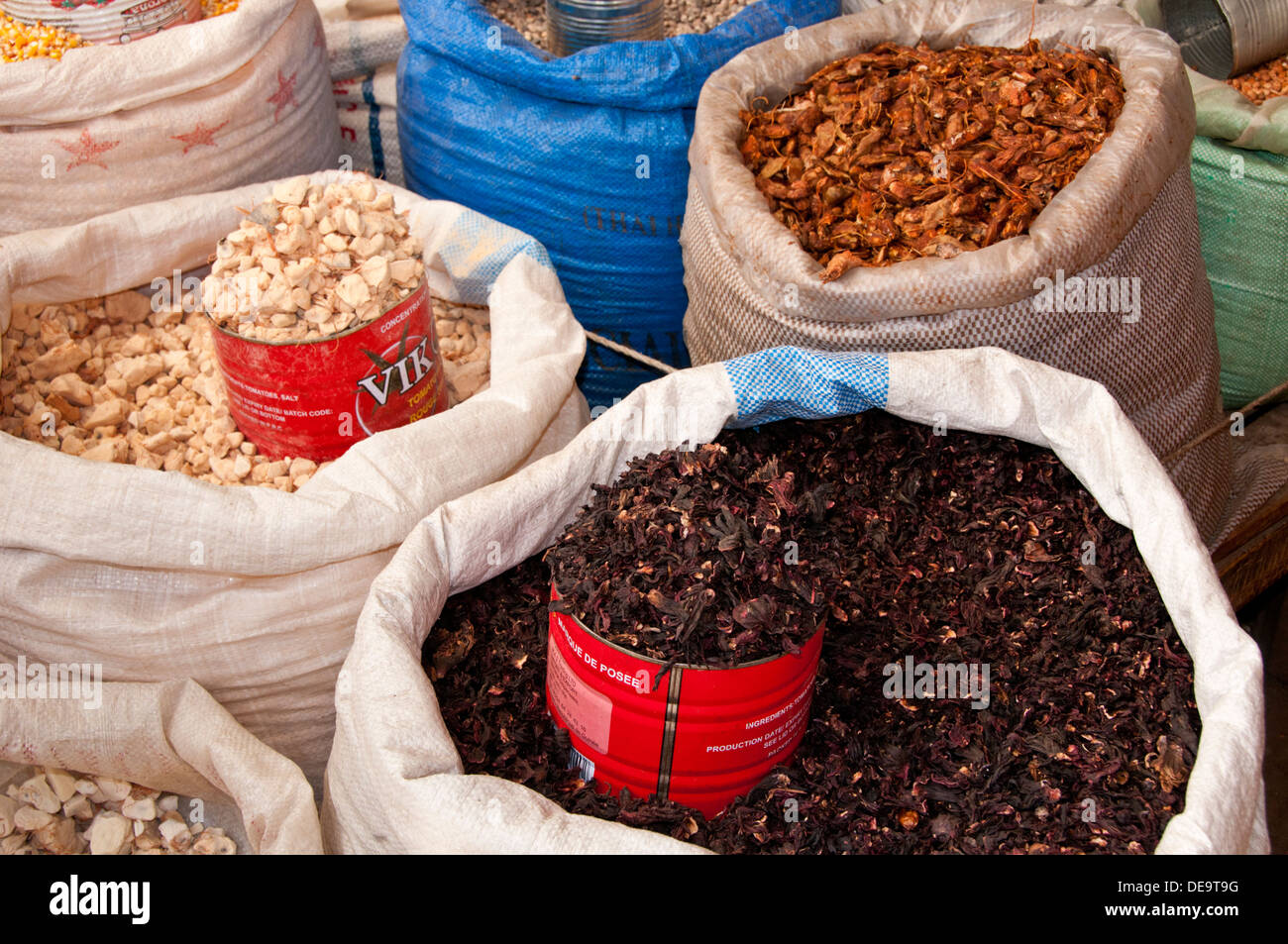 Spices and Pulses for sale in Bags in Serrekunda Market, The Gambia, West Africa - Stock Image