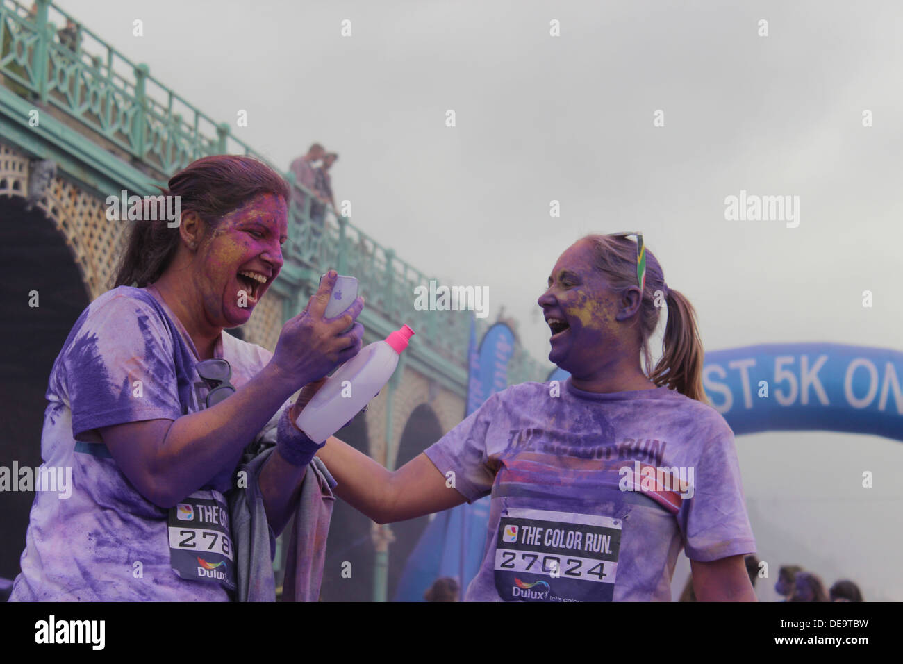 The Color Run™ event is a one of a kind experience that is less about speed and more about enjoying a color crazy day with your - Stock Image
