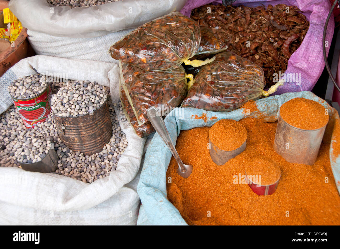 Colourful Spices and Pulses for sale in Sacks, Serrekunda Market, The Gambia, West Africa - Stock Image