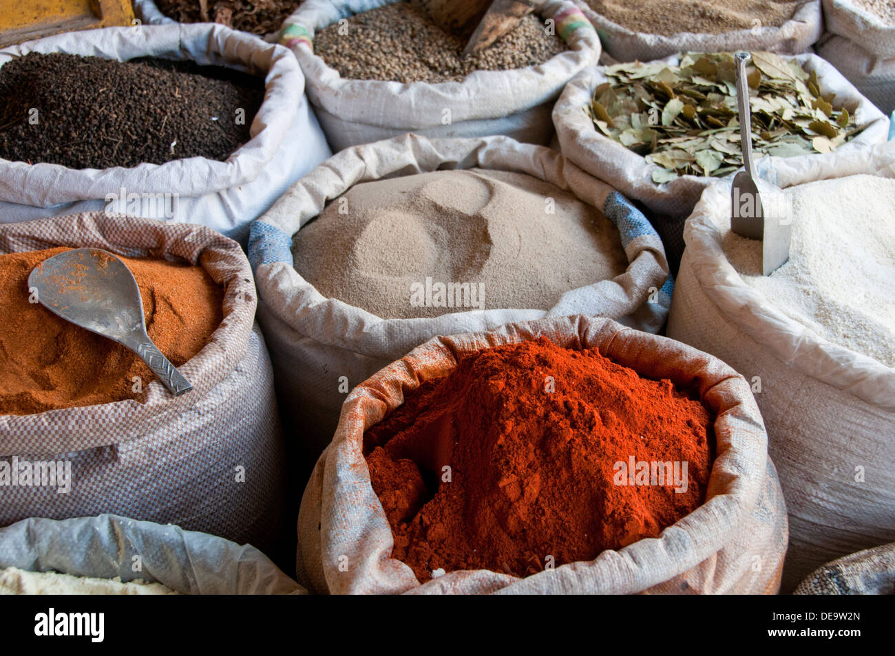 Colourful Spices and Pulses for sale in Sacks, Serrekunda Market, The Gambia, West Africa Stock Photo